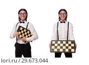 Купить «Funny man with chessboard isolated on white», фото № 29673044, снято 25 ноября 2013 г. (c) Elnur / Фотобанк Лори