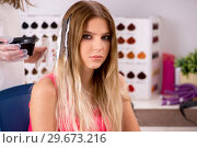 Купить «Customer choosing colour for her hair», фото № 29673216, снято 16 августа 2018 г. (c) Elnur / Фотобанк Лори