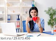 Female doctor cardiologist working in the clinic. Стоковое фото, фотограф Elnur / Фотобанк Лори