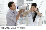 Купить «Caucasian businessman yelling through a megaphone», видеоролик № 29674016, снято 7 декабря 2019 г. (c) Wavebreak Media / Фотобанк Лори