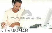 Купить «Customer agent stressed with so many bills to pay», видеоролик № 29674216, снято 22 апреля 2019 г. (c) Wavebreak Media / Фотобанк Лори