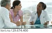 Купить «Multiethnic medical team having a brainstorming», видеоролик № 29674400, снято 1 апреля 2020 г. (c) Wavebreak Media / Фотобанк Лори