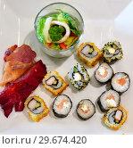Купить «Set of sushi and salad in a glass on white plate», фото № 29674420, снято 6 апреля 2018 г. (c) Володина Ольга / Фотобанк Лори
