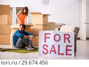 Купить «Young family offering house for sale and moving out», фото № 29674456, снято 21 сентября 2018 г. (c) Elnur / Фотобанк Лори