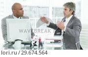 Купить «Two businessmen having an argument », видеоролик № 29674564, снято 23 марта 2019 г. (c) Wavebreak Media / Фотобанк Лори