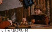 Two men playing popular strategy board game - tafl. Стоковое видео, видеограф Aleksey Popov / Фотобанк Лори