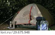 Купить «Family camping in a tent», видеоролик № 29675948, снято 7 ноября 2010 г. (c) Wavebreak Media / Фотобанк Лори