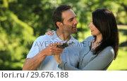 Купить «Lovely couple looking at the picture they took», видеоролик № 29676188, снято 10 ноября 2010 г. (c) Wavebreak Media / Фотобанк Лори