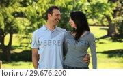 Купить «Lovely couple walking together», видеоролик № 29676200, снято 10 ноября 2010 г. (c) Wavebreak Media / Фотобанк Лори