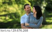 Купить «Man hugging his girlfriend», видеоролик № 29676268, снято 10 ноября 2010 г. (c) Wavebreak Media / Фотобанк Лори