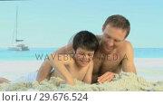 Купить «Father helping his son to build a sand castle», видеоролик № 29676524, снято 14 ноября 2010 г. (c) Wavebreak Media / Фотобанк Лори