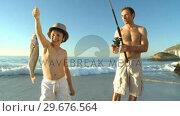 Купить «Father fishing with his boy», видеоролик № 29676564, снято 14 ноября 2010 г. (c) Wavebreak Media / Фотобанк Лори