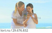 Mother and daughter taking a photo of themselves. Стоковое видео, агентство Wavebreak Media / Фотобанк Лори