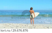 Купить «Woman on beach with surf board », видеоролик № 29676876, снято 15 ноября 2010 г. (c) Wavebreak Media / Фотобанк Лори