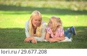 Купить «Young girl talking with her mother», видеоролик № 29677208, снято 16 ноября 2010 г. (c) Wavebreak Media / Фотобанк Лори
