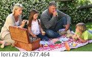 Купить «Family picnic on lawn», видеоролик № 29677464, снято 6 ноября 2010 г. (c) Wavebreak Media / Фотобанк Лори