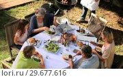 Купить «Family Barbecue meal in garden», видеоролик № 29677616, снято 6 ноября 2010 г. (c) Wavebreak Media / Фотобанк Лори