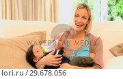 Купить «Woman bottlefeeding her son», видеоролик № 29678056, снято 6 ноября 2010 г. (c) Wavebreak Media / Фотобанк Лори