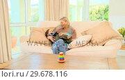 Купить «Cute mother with her baby», видеоролик № 29678116, снято 6 ноября 2010 г. (c) Wavebreak Media / Фотобанк Лори