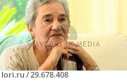 Купить «Pensive elderly woman », видеоролик № 29678408, снято 5 ноября 2010 г. (c) Wavebreak Media / Фотобанк Лори