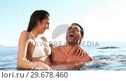 Купить «Happy couple in a swimming pool», видеоролик № 29678460, снято 2 ноября 2011 г. (c) Wavebreak Media / Фотобанк Лори