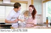 Купить «Parents tickling their son», видеоролик № 29678508, снято 2 ноября 2011 г. (c) Wavebreak Media / Фотобанк Лори