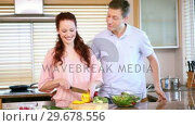 Купить «Woman chopping peppers in front of her boyfriend», видеоролик № 29678556, снято 2 ноября 2011 г. (c) Wavebreak Media / Фотобанк Лори