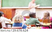 Купить «Pupils working in class», видеоролик № 29678624, снято 5 ноября 2011 г. (c) Wavebreak Media / Фотобанк Лори