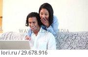 Купить «Woman embracing her boyfriend», видеоролик № 29678916, снято 3 ноября 2011 г. (c) Wavebreak Media / Фотобанк Лори