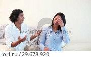 Купить «Young couple having argument», видеоролик № 29678920, снято 3 ноября 2011 г. (c) Wavebreak Media / Фотобанк Лори