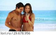 Купить «Smiling couple photographing themselves», видеоролик № 29678956, снято 15 ноября 2011 г. (c) Wavebreak Media / Фотобанк Лори