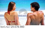 Купить «Smiling couple sitting together», видеоролик № 29678980, снято 15 ноября 2011 г. (c) Wavebreak Media / Фотобанк Лори
