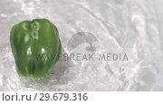Купить «Pepper turning in water in super slow motion», видеоролик № 29679316, снято 26 января 2012 г. (c) Wavebreak Media / Фотобанк Лори