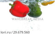 Купить «Peppers diving into water in super slow motion», видеоролик № 29679560, снято 26 января 2012 г. (c) Wavebreak Media / Фотобанк Лори