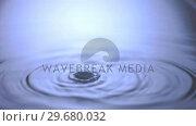 Купить «Two water drops falling in super slow motion», видеоролик № 29680032, снято 26 января 2012 г. (c) Wavebreak Media / Фотобанк Лори