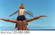 Купить «Father holding his son in slow motion», видеоролик № 29680088, снято 15 ноября 2011 г. (c) Wavebreak Media / Фотобанк Лори