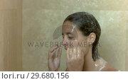 Купить «Young brunette in slow motion showering», видеоролик № 29680156, снято 7 ноября 2011 г. (c) Wavebreak Media / Фотобанк Лори