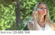 Купить «Blonde woman in slow motion making bubbles», видеоролик № 29680164, снято 14 ноября 2011 г. (c) Wavebreak Media / Фотобанк Лори