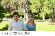 Купить «Couple walking up to the camera as they point and laugh and then wave into the camera», видеоролик № 29680368, снято 17 ноября 2011 г. (c) Wavebreak Media / Фотобанк Лори