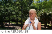 Купить «A woman walks and takes a drink before wiping her head and walking again», видеоролик № 29680428, снято 17 ноября 2011 г. (c) Wavebreak Media / Фотобанк Лори
