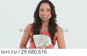 Купить «Woman with Money », видеоролик № 29680616, снято 11 ноября 2011 г. (c) Wavebreak Media / Фотобанк Лори