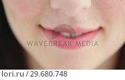 Купить «Brunette woman with a beaming smile», видеоролик № 29680748, снято 22 ноября 2011 г. (c) Wavebreak Media / Фотобанк Лори