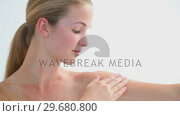 Купить «Peaceful blonde woman massaging her shoulder», видеоролик № 29680800, снято 22 ноября 2011 г. (c) Wavebreak Media / Фотобанк Лори