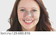 Купить «Attractive woman showing a beaming smile», видеоролик № 29680816, снято 22 ноября 2011 г. (c) Wavebreak Media / Фотобанк Лори
