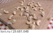 Купить «Cashew nuts falling in super slow motion», видеоролик № 29681048, снято 24 февраля 2012 г. (c) Wavebreak Media / Фотобанк Лори