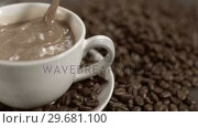 Купить «Sugar cube falling in super slow motion in white coffee», видеоролик № 29681100, снято 24 февраля 2012 г. (c) Wavebreak Media / Фотобанк Лори