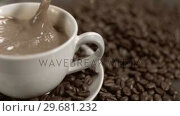 Купить «Sugar cube diving in super slow motion in a white coffee», видеоролик № 29681232, снято 24 февраля 2012 г. (c) Wavebreak Media / Фотобанк Лори