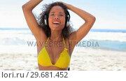 Купить «Tanned woman using headphones», видеоролик № 29681452, снято 18 ноября 2011 г. (c) Wavebreak Media / Фотобанк Лори
