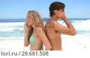 Купить «Couple back-to-back on the phone», видеоролик № 29681508, снято 18 ноября 2011 г. (c) Wavebreak Media / Фотобанк Лори