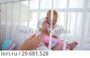 Купить «Mother giving a cuddly toy to her baby», видеоролик № 29681528, снято 25 ноября 2011 г. (c) Wavebreak Media / Фотобанк Лори
